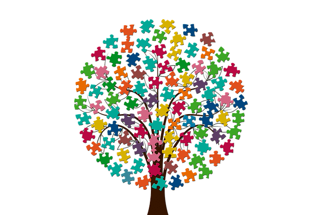 A tree with pieces of puzzle instead of leaves.